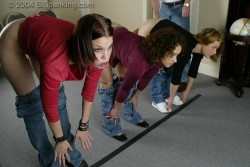 Claire and Jasmine from bispanking.com assume the position with Kailee.&nbsp; Mr. M makes several trips down the line applying severe paddle swats until all three bottoms are black and blue.