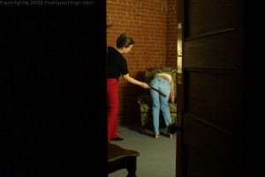 April from Realspankings.com struggles to make it through her severe strapping, while the punishment is secretely watched from the next room